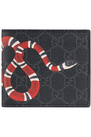 Gucci GG Supreme plånbok med ormtryck