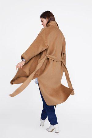 Zara Kappa med fickor och skärp