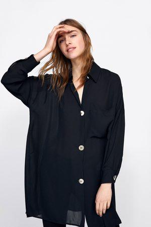 Zara Oversizeskjorta med guldfärgade knappar