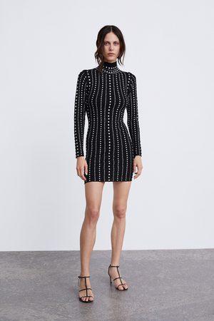 Zara Stickad klänning med nitar