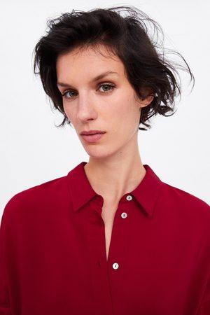 Zara Lång oversizeskjorta.
