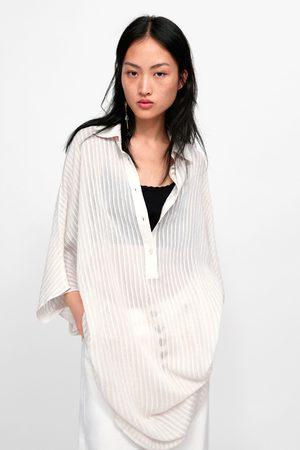Zara priser kvinna blusar   tunikor e47b27e4ce3f1