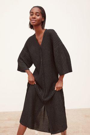 Zara Stickad klänning med glitter