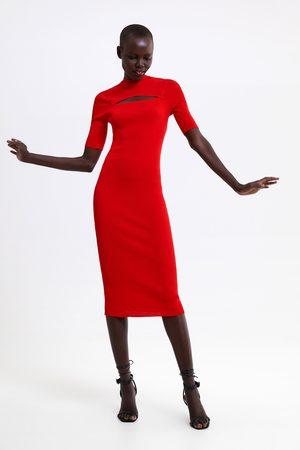 Zara Stickad klänning med cut out