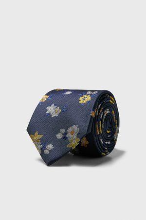 Zara Bred och blommönstrad slips