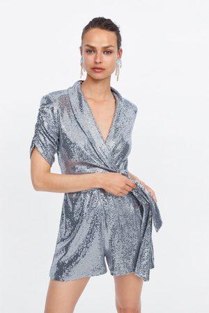 Zara Kort och glittrig jumpsuit