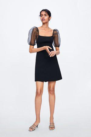 Zara Stickad klänning med långa puffärmar