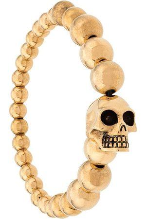 Alexander McQueen Pärlat armband med dödskalle