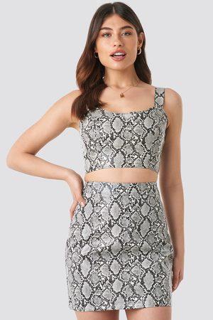 NA-KD Kvinna Mönstrade kjolar - Snake Printed PU Mini Skirt
