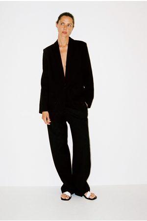 Zara Kavaj med fickor