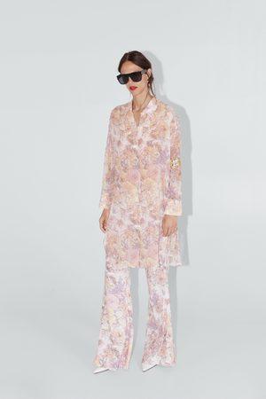 Zara Utsvängda jeans med blomtryck