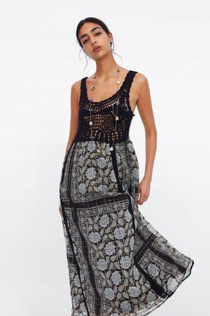 Zara Mönstrad klänning med metalltråd