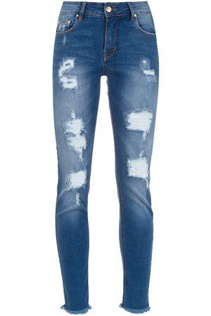 AMAPÔ Smala jeans med sliten effekt