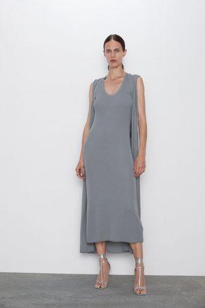 Zara Stickad strukturklänning