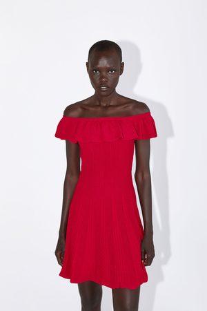 Zara Stickad klänning med volang