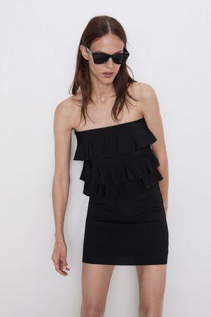 Zara Stickad klänning med volanger