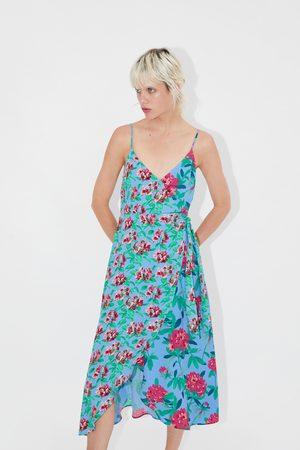 Zara Mönstrad och asymmetrisk klänning