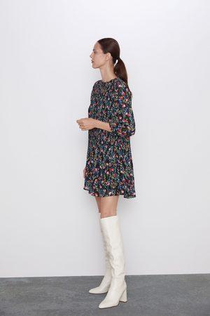 Zara Mönstrad och plisserad klänning