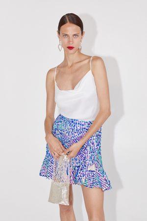 Zara Minikjol med paljetter och volang