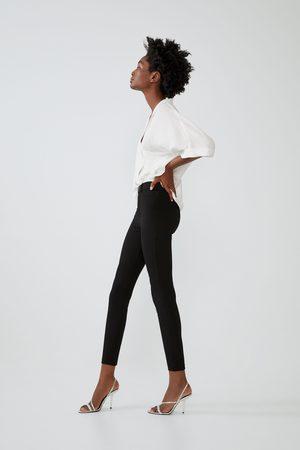 Zara Leggings med knapp