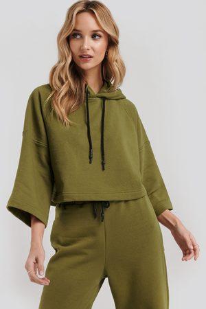 NA-KD Half Sleeve Cropped Hoodie - Sweatshirts - Grön - Small