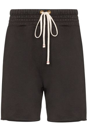 Les Tien Shorts med dragsko och sliten kant