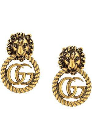 Gucci örhängen med lejonhuvud