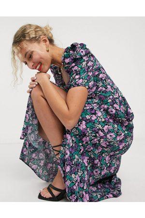 & OTHER STORIES – Miami – blommig midiklänning med tuff axel