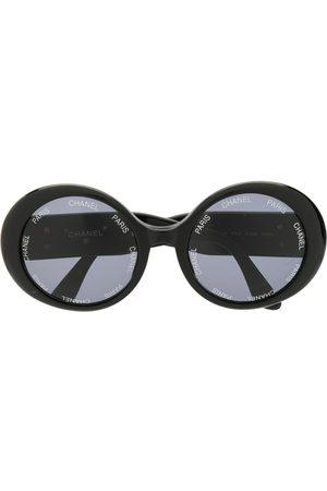 CHANEL Runda solglasögon med logotyp