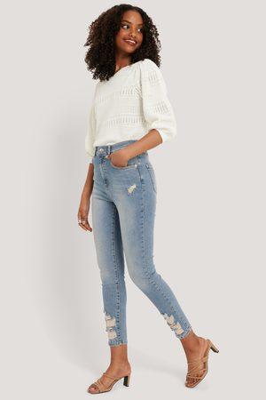 NA-KD Chewed Hem Skinny Cropped Jeans