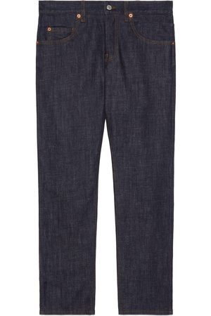 Gucci Washed denim tapered trousers