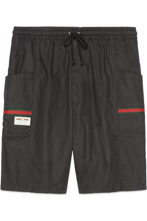 Gucci Man Shorts - Coated cotton shorts with label