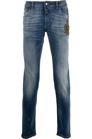 Dolce & Gabbana Beaded crown slim-fit jeans