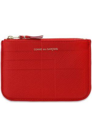 Comme des Garçons Leather pouch with logo