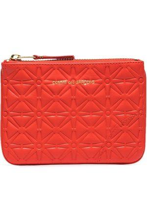 Comme des Garçons Embossed-pattern leather pouch