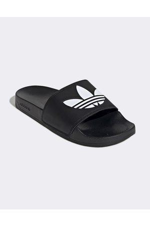 adidas – adilette Lite – Svarta tofflor