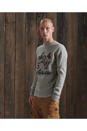 Superdry Man Sweatshirts - Vintage rundhalsad sweatshirt med påsydda märken