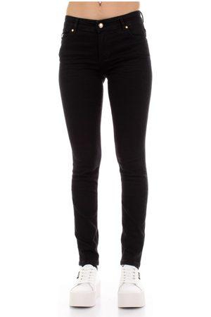 VERSACE A1Hvb0K4-60366 Skinny jeans