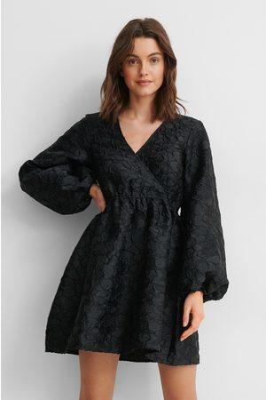 NA-KD Kvinna Festklänningar - Miniklänning Med Struktur Och Ballongärm