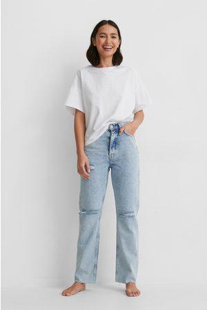 NA-KD Kvinna High waist - Ekologiska Jeans Med Slitningar På Knäet Och Hög Midja