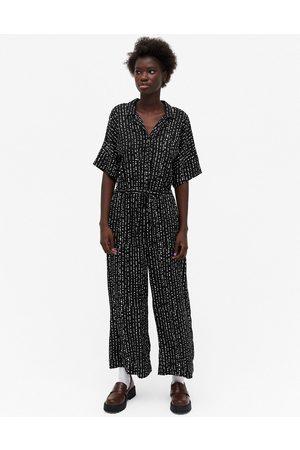 Monki Kvinna Playsuits - – Kalolo – Svart och jumpsuit med korta ärmar