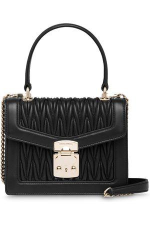 Miu Miu Confidential tote-väska med lädereffekt