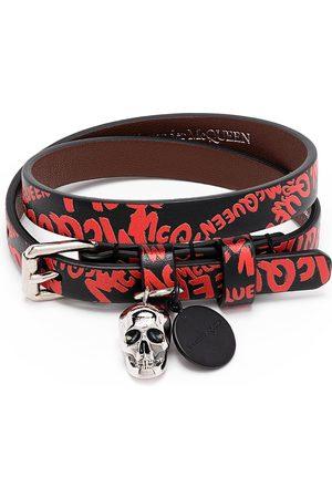 Alexander McQueen Graffitimönstrat armband med dödskalle