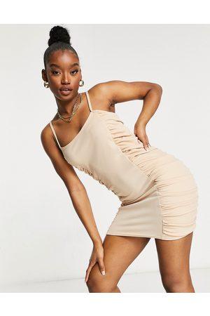 Femme Luxe – Stenfärgad rynkad miniklänning