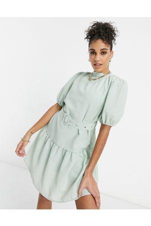 Unique 21 – Smockklänning med skärp