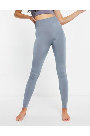 ASOS – Metalliska leggings i seamless modell