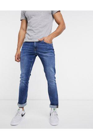 Calvin Klein – Mellanblå jeans i smal passform