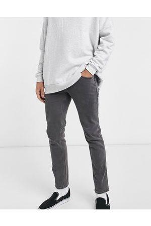 ASOS – Svarttvättade, stretchiga smala jeans