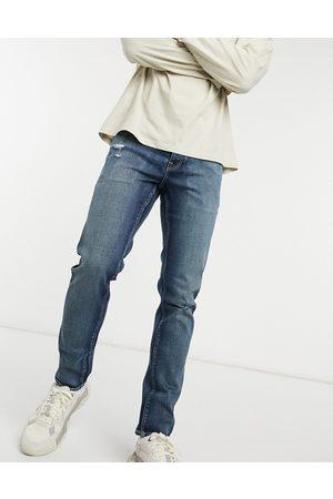 ASOS – Mörkblå slim jeans med stretch i japansk vintagetvätt med nötta delar