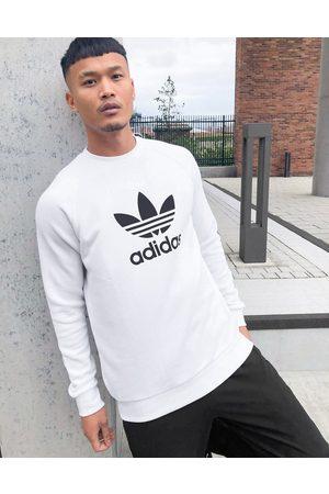 adidas – sweatshirt med stor treklöverlogga
